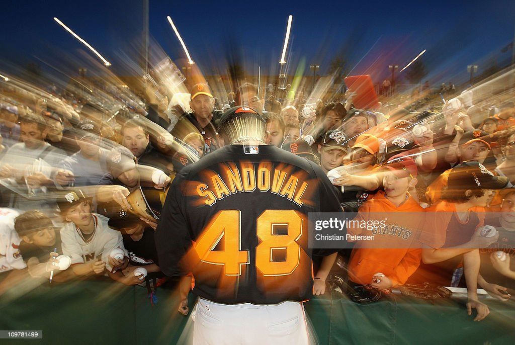 <a gi-track='captionPersonalityLinkClicked' href=/galleries/search?phrase=Pablo+Sandoval&family=editorial&specificpeople=803207 ng-click='$event.stopPropagation()'>Pablo Sandoval</a> #48 of the San Francisco Giants signs autographs for fans before start of the spring training game against the Los Angeles Dodgers at Camelback Ranch on March 4, 2011 in Glendale, Arizona.