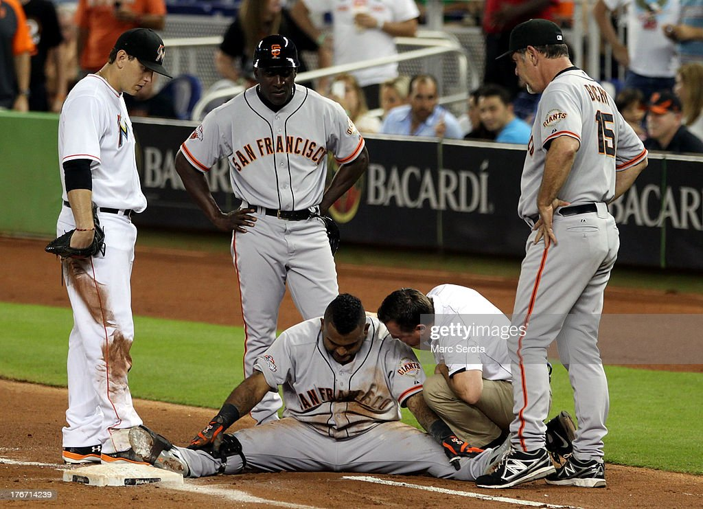 <a gi-track='captionPersonalityLinkClicked' href=/galleries/search?phrase=Pablo+Sandoval&family=editorial&specificpeople=803207 ng-click='$event.stopPropagation()'>Pablo Sandoval</a> #48 (C) of the San Francisco Giants sits on the ground after diving into first base against the Miami Marlins during the fourth inning at Marlins Park on August 17, 2013 in Miami, Florida.