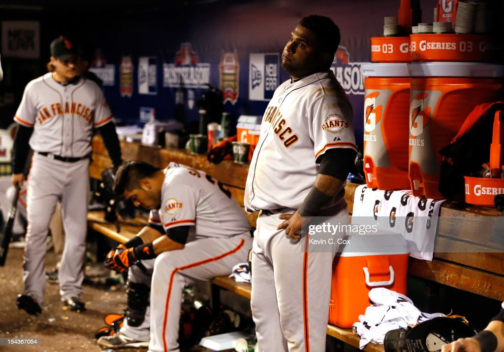 <a gi-track='captionPersonalityLinkClicked' href=/galleries/search?phrase=Pablo+Sandoval&family=editorial&specificpeople=803207 ng-click='$event.stopPropagation()'>Pablo Sandoval</a> #48 of the San Francisco Giants stands in the dugout in the ninth inning while taking on the St. Louis Cardinals in Game Four of the National League Championship Series at Busch Stadium on October 18, 2012 in St Louis, Missouri.