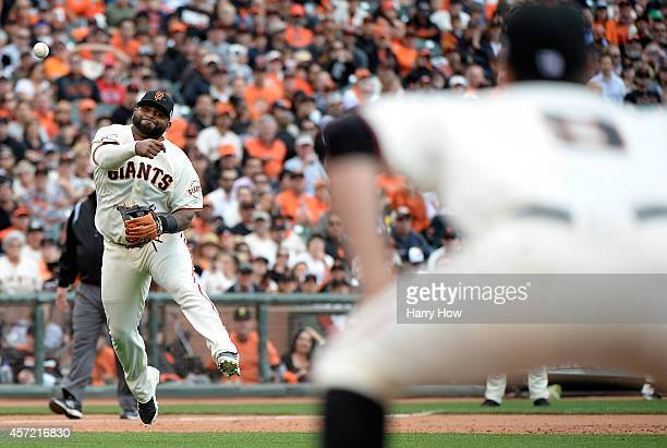 Pablo Sandoval of the San Francisco Giants throws out Matt Holliday of the St Louis Cardinals in the sixth inning during Game Three of the National...