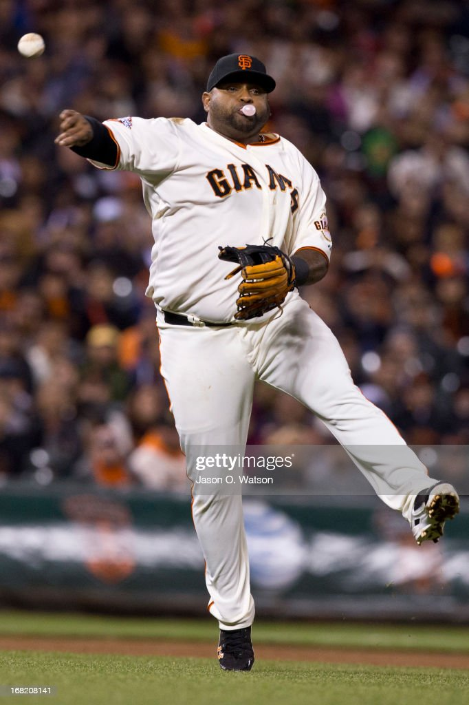 <a gi-track='captionPersonalityLinkClicked' href=/galleries/search?phrase=Pablo+Sandoval&family=editorial&specificpeople=803207 ng-click='$event.stopPropagation()'>Pablo Sandoval</a> #48 of the San Francisco Giants throws to first base while blowing a bubble after fielding a ground ball hit off the bat of Chase Utley #26 of the Philadelphia Phillies (not pictured) during the fourth inning at AT&T Park on May 6, 2013 in San Francisco, California.