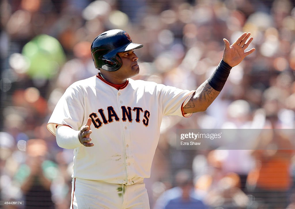 Pablo Sandoval #48 of the San Francisco Giants waves to the crowd after he scored on a hit by Andrew Susac #34 in the second inning of their game against the Milwaukee Brewers at AT&T Park on August 31, 2014 in San Francisco, California.