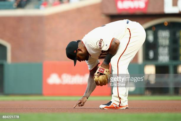 Pablo Sandoval of the San Francisco Giants writes in the dirt before the start of the first inning of their game against the Philadelphia Phillies at...