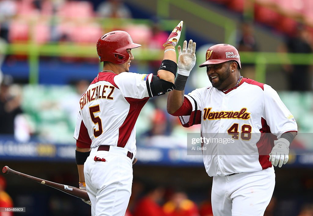 <a gi-track='captionPersonalityLinkClicked' href=/galleries/search?phrase=Pablo+Sandoval&family=editorial&specificpeople=803207 ng-click='$event.stopPropagation()'>Pablo Sandoval</a> #48 of Venezuela celebrates his home run with Carlos Gonzales #5 after hitting a home run against Spain during the first round of the World Baseball Classic at Hiram Bithorn Stadium on March 10, 2013 in San Juan, Puerto Rico.