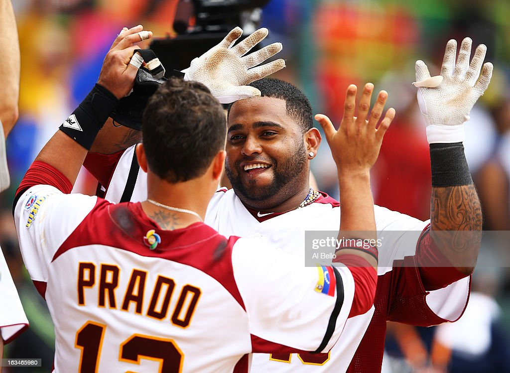 <a gi-track='captionPersonalityLinkClicked' href=/galleries/search?phrase=Pablo+Sandoval&family=editorial&specificpeople=803207 ng-click='$event.stopPropagation()'>Pablo Sandoval</a> #48 of Venezuela celebrates his home run with <a gi-track='captionPersonalityLinkClicked' href=/galleries/search?phrase=Martin+Prado&family=editorial&specificpeople=620159 ng-click='$event.stopPropagation()'>Martin Prado</a> #12 after hitting a home run against Spain during the first round of the World Baseball Classic at Hiram Bithorn Stadium on March 10, 2013 in San Juan, Puerto Rico.