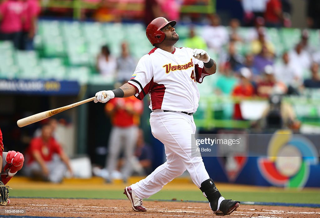 <a gi-track='captionPersonalityLinkClicked' href=/galleries/search?phrase=Pablo+Sandoval&family=editorial&specificpeople=803207 ng-click='$event.stopPropagation()'>Pablo Sandoval</a> #48 of Venezuela hit a home run against Spain during the first round of the World Baseball Classic at Hiram Bithorn Stadium on March 10, 2013 in San Juan, Puerto Rico.