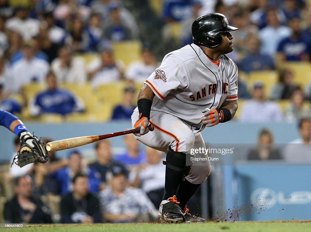 <a gi-track='captionPersonalityLinkClicked' href=/galleries/search?phrase=Pablo+Sandoval&family=editorial&specificpeople=803207 ng-click='$event.stopPropagation()'>Pablo Sandoval</a>#48 of the San Francisco Giants leads off the ninth inning with a single against the Los Angeles Dodgers at Dodger Stadium on September 12, 2013 in Los Angeles, California.