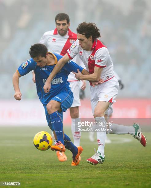 Pablo Sarabia of Getafe CF competes for the ball with Raul Baena of Rayo Vallecano de Madrid during the La Liga match between Getafe CF and Rayo...