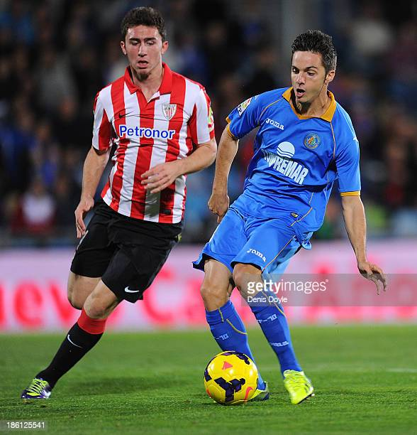 Pablo Sarabia of Getafe is tackled by Aymeric Laporte of Athletic Club during the La Liga match between Getafe CF and Athletic Club at Coliseum...