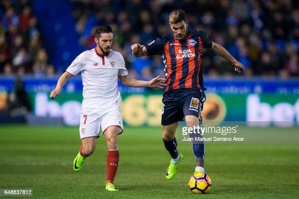 Pablo Sarabia of Sevilla FC duels for the ball with Theo Hernandez of Deportivo Alaves during the La Liga match between Deportivo Alaves and Sevilla...