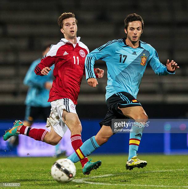 Pablo Sarabia of Spain and Andreas Laudrup of Denmark in action during the UEFA European Under21 Championship playoff second leg match between...