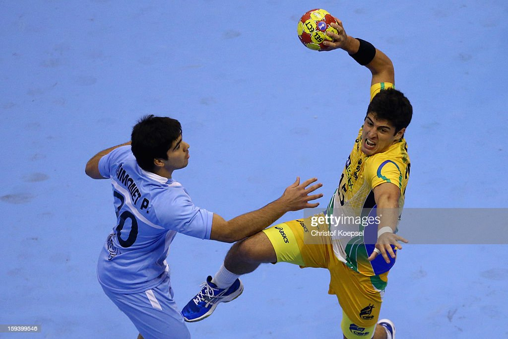 Pablo Smonet of Argentina defends against Arthur Patrianova of Brazil during the premilary group A match between Brasil and Argentina and Montenegro at Palacio de Deportes de Granollers on January 13, 2013 in Granollers, Spain.