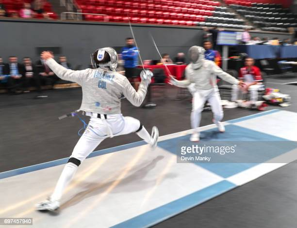 Pablo Trochez of Colombia makes an attack against Jose Quintero of Venezuela during the bronze medal match in the Team Men's Sabre event on June 18...