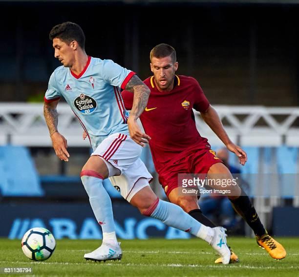 Pablo 'Tucu' Hernandez of Celta de Vigo beats Kevin Strootman of AS Roma during the preseason friendly match between Celta de Vigo and AS Roma at...