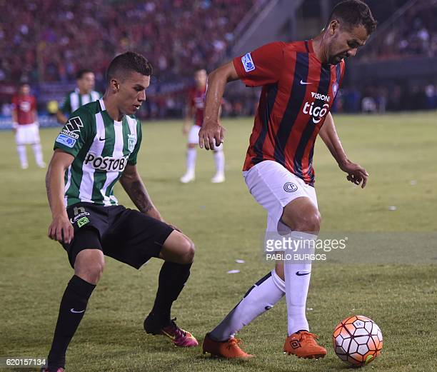 Pablo Velazquez of Paraguay's Cerro Porteno and Mateus Uribe of Colombia's Atletico Nacional vie for the ball during their Copa Sudamericana...