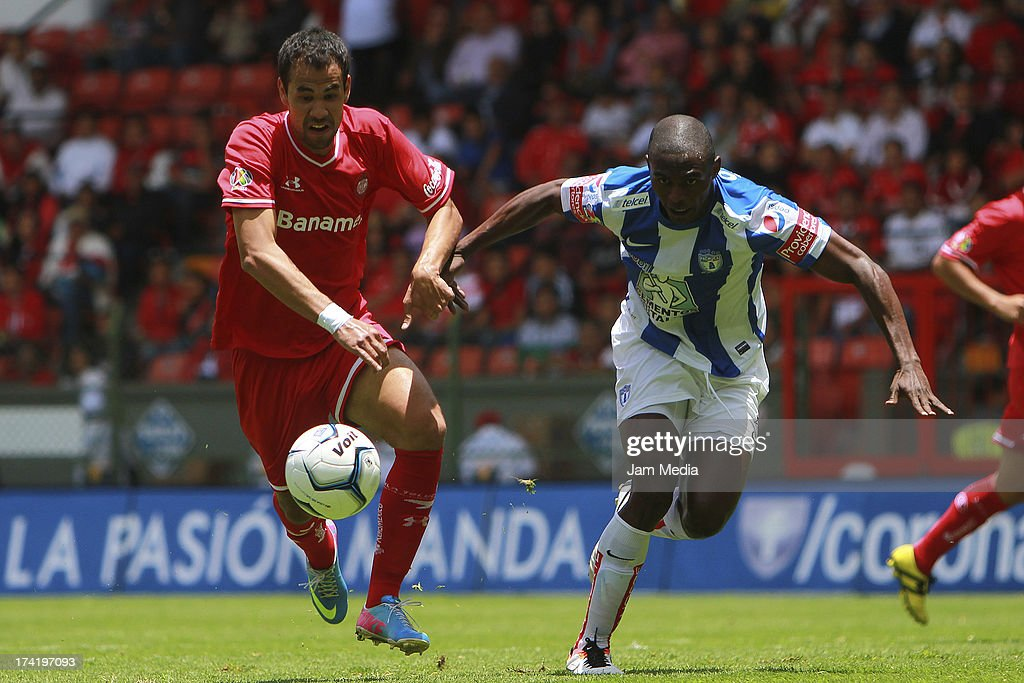 Pablo Velazquez (L) of Toluca struggles for the ball with Efrain Cortes (L) of Tijuana during the match between Toluca and Pachuca as part of the Apertura 2013 Liga Bancomer MX at Nemesio Diez Stadium on july 21, 2013 in Toluca, Mexico.