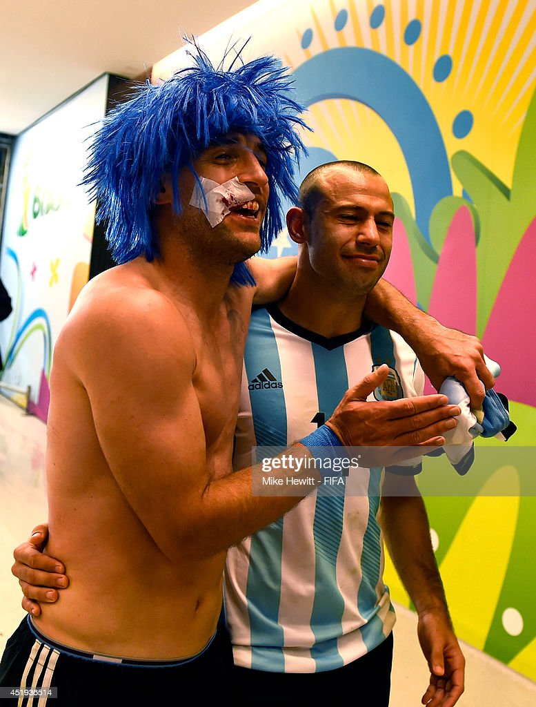 Pablo Zabaleta (L) and Javier Mascherano (R) of Argentina celebrate the win in the penalty shootout in the tunnel after the 2014 FIFA World Cup Brazil Semi Final match between Netherlands and Argentina at Arena de Sao Paulo on July 9, 2014 in Sao Paulo, Brazil.