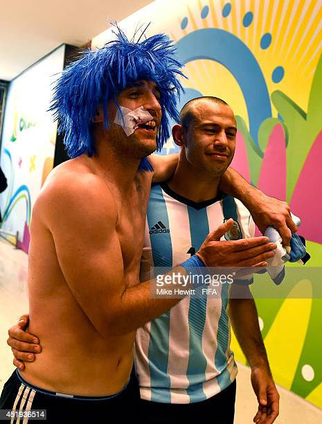 Pablo Zabaleta and Javier Mascherano of Argentina celebrate the win in the penalty shootout in the tunnel after the 2014 FIFA World Cup Brazil Semi...