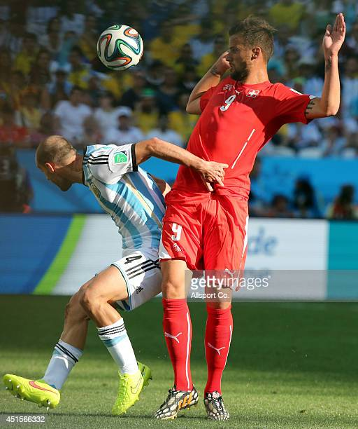 Pablo Zabaleta of Argentina holds off Haris Seferovic of Switzerland during the 2014 FIFA World Cup Brazil Round of 16 match between Argentina and...