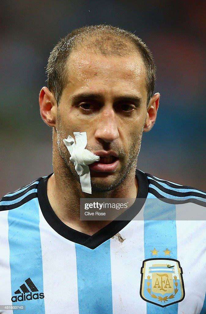 Pablo Zabaleta of Argentina looks on after receiving treatment during the 2014 FIFA World Cup Brazil Semi Final match between the Netherlands and Argentina at Arena de Sao Paulo on July 9, 2014 in Sao Paulo, Brazil.