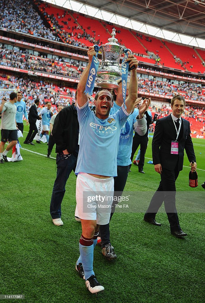 Pablo Zabaleta of Man City lifts the trophy during the The FA Cup sponsored by E.0N 2011 Final match between Manchester City and Stoke City at Wembley Stadium on May 14, 2011 in London, England.