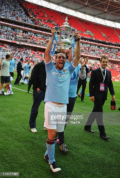 Pablo Zabaleta of Man City lifts the trophy during the The FA Cup sponsored by E0N 2011 Final match between Manchester City and Stoke City at Wembley...