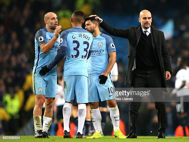 Pablo Zabaleta of Manchester City and Gabriel Jesus of Manchester City embrace while Josep Guardiola Manager of Manchester City pats him on the back...