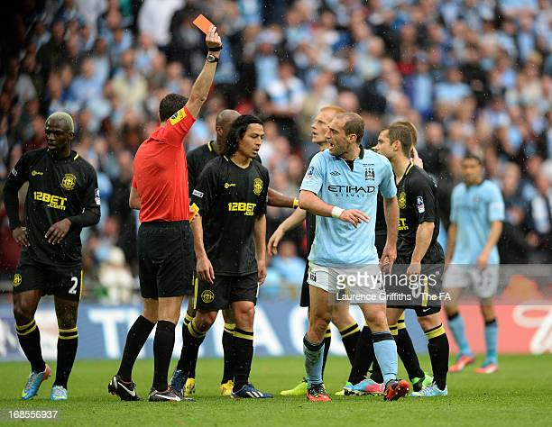 Pablo Zabaleta of Manchester City argues as he receives a red card from referee Andre Marriner during the FA Cup with Budweiser Final match between...
