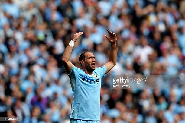 Pablo Zabaleta of Manchester City celebrates after scoring the opening goal during the Barclays Premier League match between Manchester City and...
