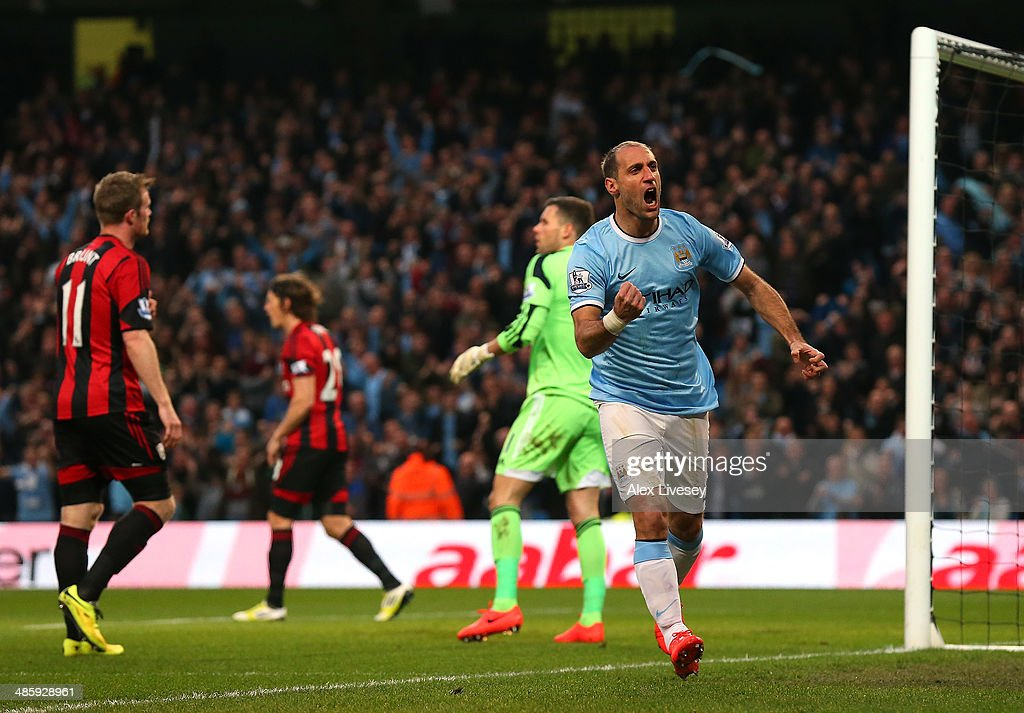Pablo Zabaleta of Manchester City celebrates after scoring the opening goal during the Barclays Premier League match between Manchester City and West Bromwich Albion at Etihad Stadium on April 21, 2014 in Manchester, England.