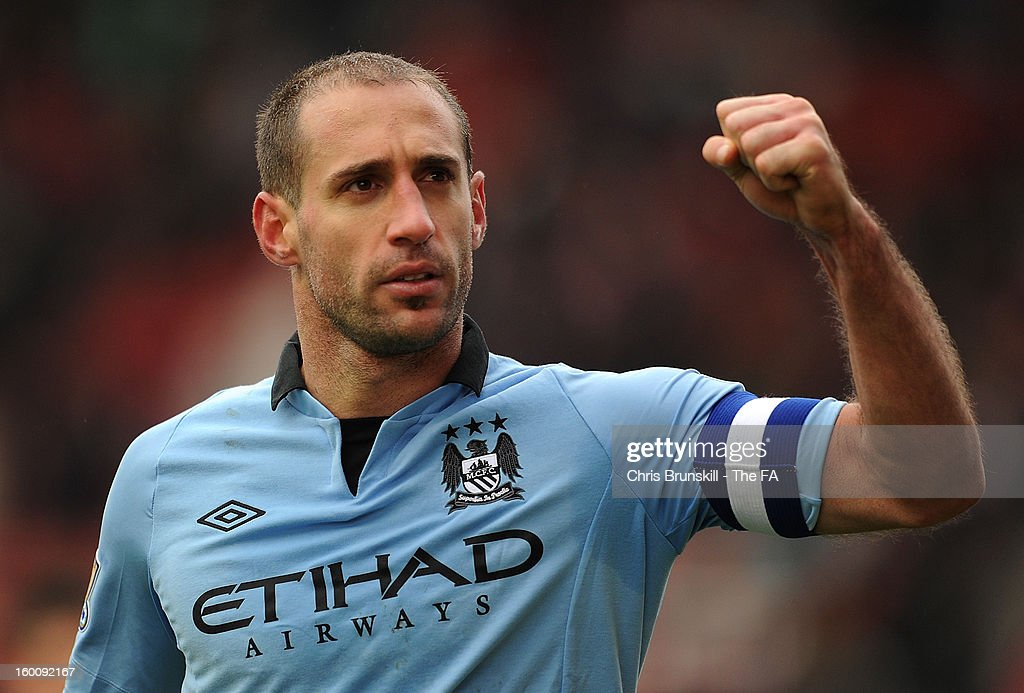Pablo Zabaleta of Manchester City celebrates at full-time following the FA Cup with Budweiser Fourth Round match between Stoke City and Manchester City at Britannia Stadium on January 26, 2013 in Stoke on Trent, England.