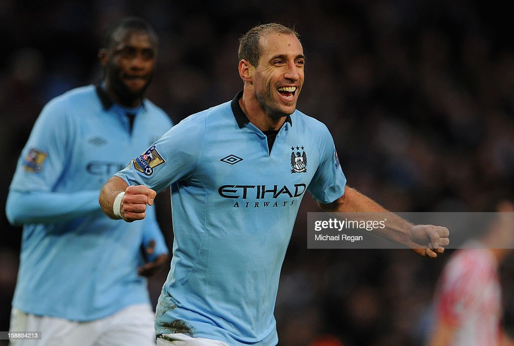 Pablo Zabaleta of Manchester City celebrates scoring the opening goal during the Barclays Premier League match between Manchester City and Stoke City at the Etihad Stadium on January 1, 2013 in Manchester, England.
