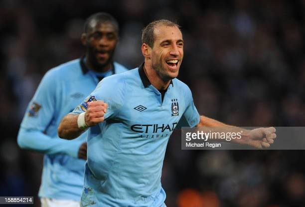 Pablo Zabaleta of Manchester City celebrates scoring the opening goal during the Barclays Premier League match between Manchester City and Stoke City...