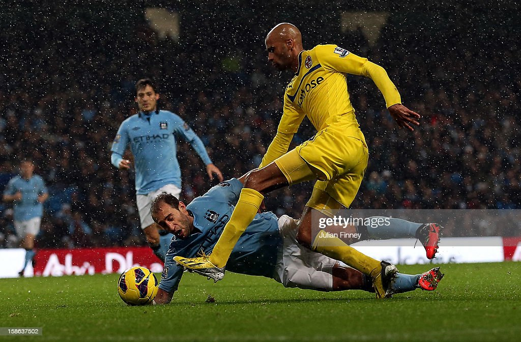 Pablo Zabaleta of Manchester City goes down under the challenge of <a gi-track='captionPersonalityLinkClicked' href=/galleries/search?phrase=Jimmy+Kebe&family=editorial&specificpeople=2953929 ng-click='$event.stopPropagation()'>Jimmy Kebe</a> of Reading during the Barclays Premier League match between Manchester City and Reading at Etihad Stadium on December 22, 2012 in Manchester, England.