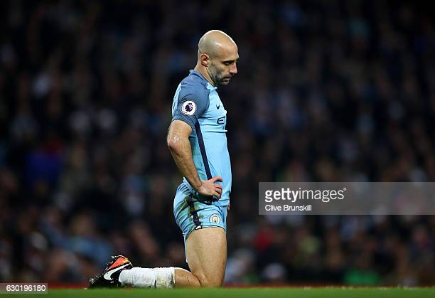 Pablo Zabaleta of Manchester City is dejected after Arsenal score their first goal during the Premier League match between Manchester City and...