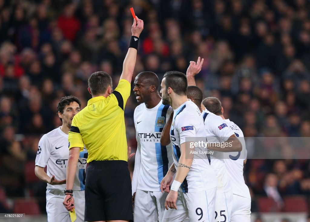 Pablo Zabaleta of Manchester City is sent off by referee <a gi-track='captionPersonalityLinkClicked' href=/galleries/search?phrase=Stephane+Lannoy&family=editorial&specificpeople=2274380 ng-click='$event.stopPropagation()'>Stephane Lannoy</a> during the UEFA Champions League Round of 16 match between FC Barcelona and Manchester City at Camp Nou on March 12, 2014 in Barcelona, Spain.