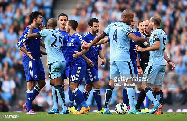 Pablo Zabaleta of Manchester City is separated from Diego Costa of Chelsea by his teammates during the Barclays Premier League match between...