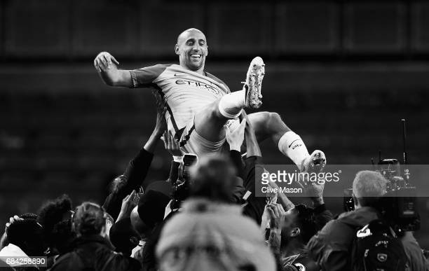 Pablo Zabaleta of Manchester City is thrown into the air by his Manchester City team mates after the Premier League match between Manchester City and...
