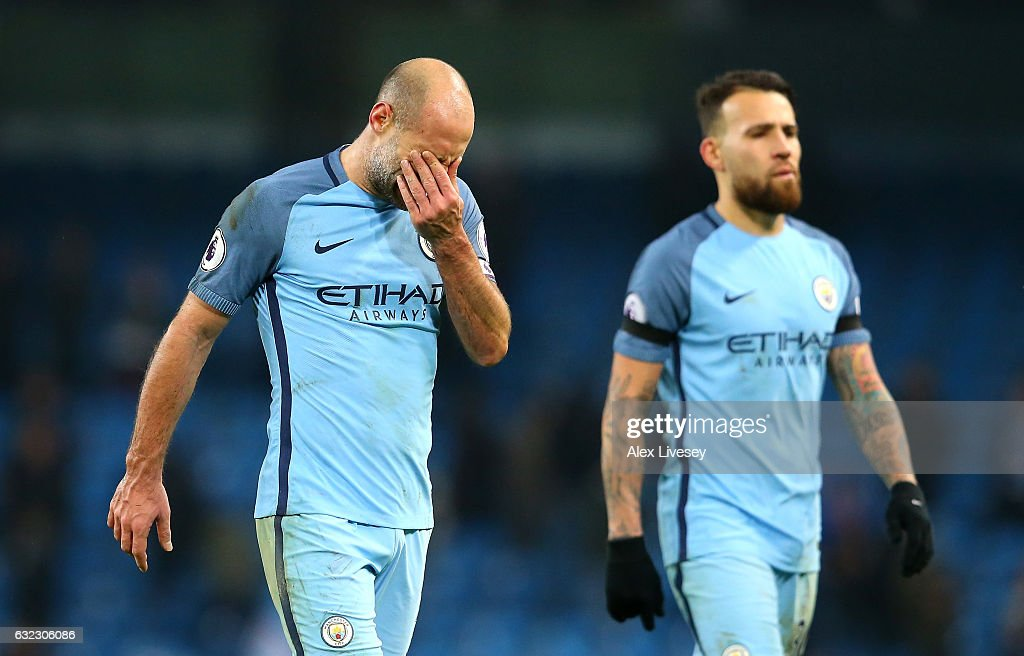Pablo Zabaleta of Manchester City (L) looks dejected after the Premier League match between Manchester City and Tottenham Hotspur at the Etihad Stadium on January 21, 2017 in Manchester, England.