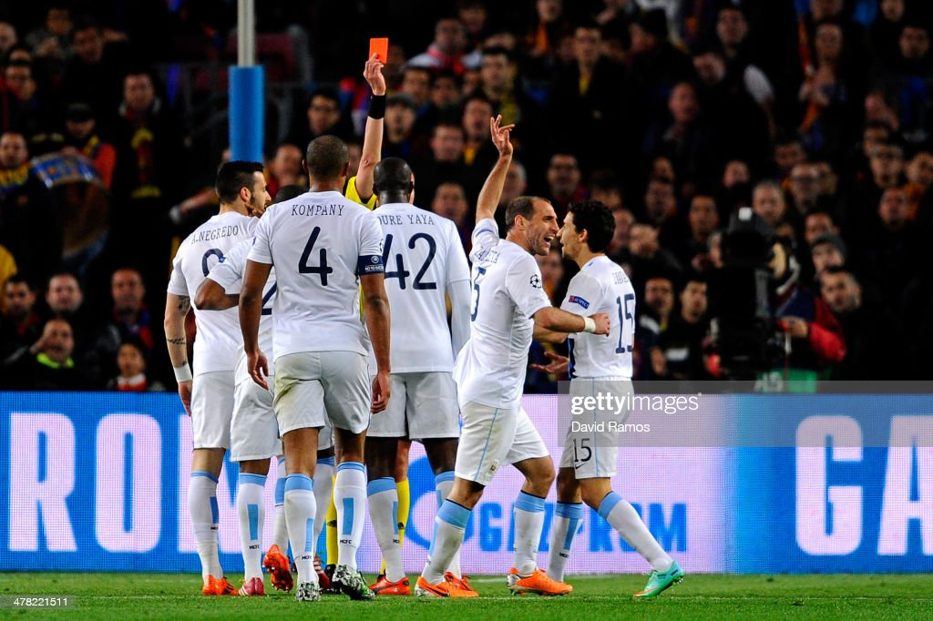 Pablo Zabaleta of Manchester City reacts angrily as he is shown the red card by Referee <a gi-track='captionPersonalityLinkClicked' href=/galleries/search?phrase=Stephane+Lannoy&family=editorial&specificpeople=2274380 ng-click='$event.stopPropagation()'>Stephane Lannoy</a> of France during the UEFA Champions League Round of 16, second leg match between FC Barcelona and Manchester City at Camp Nou on March 12, 2014 in Barcelona, Spain.