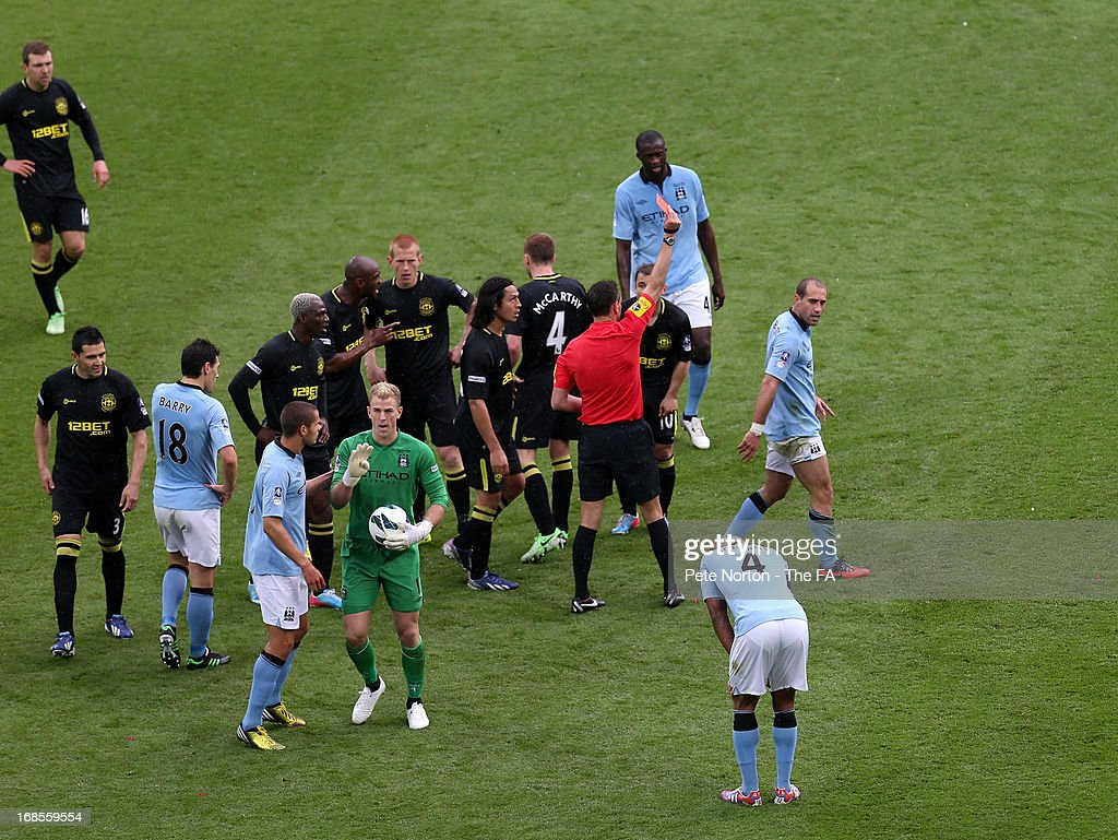 Pablo Zabaleta of Manchester City receives a red card from referee <a gi-track='captionPersonalityLinkClicked' href=/galleries/search?phrase=Andre+Marriner&family=editorial&specificpeople=221003 ng-click='$event.stopPropagation()'>Andre Marriner</a> during the FA Cup with Budweiser Final match between Manchester City and Wigan Athletic at Wembley Stadium on May 11, 2013 in London, England.