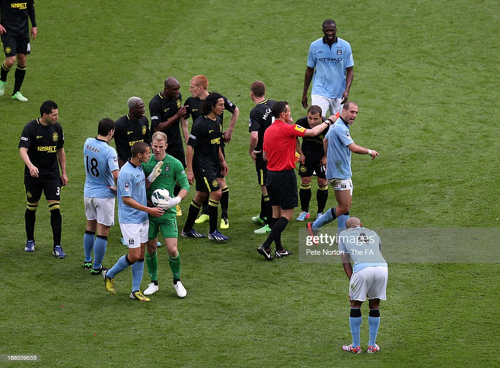 Pablo Zabaleta of Manchester City receives a red card from referee Andre Marriner during the FA Cup with Budweiser Final match between Manchester...