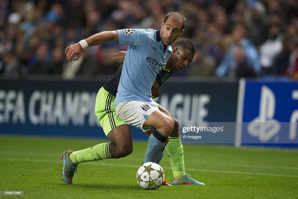 Pablo Zabaleta of Manchester City, Ryan Babel of Ajax during the Champions League match between Manchester City and Ajax Amsterdam at the Etihad Stadium on November 06, 2012 in Manchester, United Kingdom.
