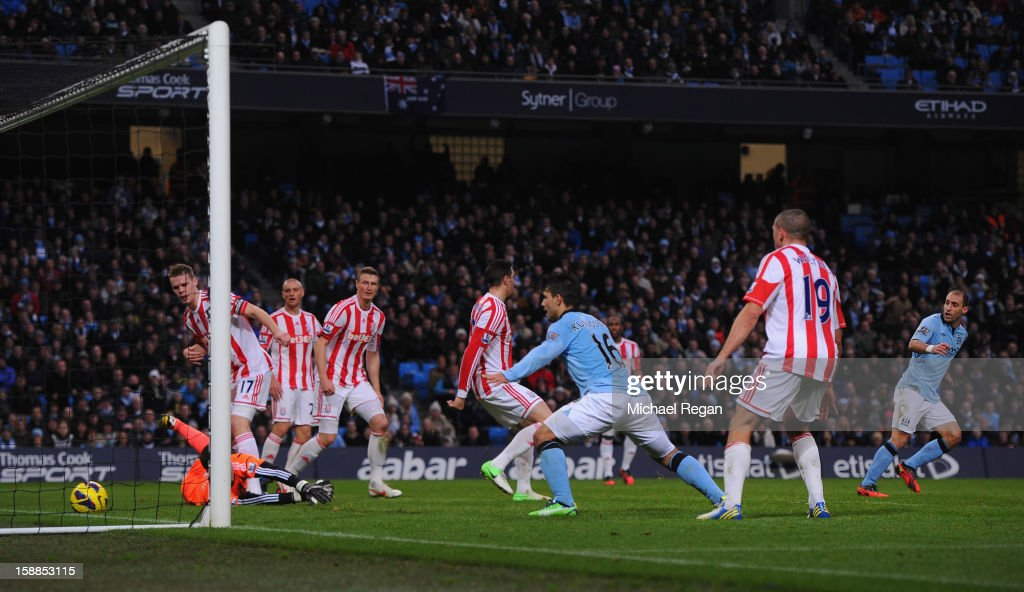 Pablo Zabaleta of Manchester City scores the opening goal during the Barclays Premier League match between Manchester City and Stoke City at the Etihad Stadium on January 1, 2013 in Manchester, England.