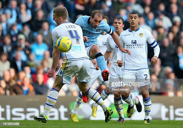 Pablo Zabaleta of Manchester City shoots past Tom Lees of Leeds United during the FA Cup with Budweiser Fifth Round match between Manchester City and...
