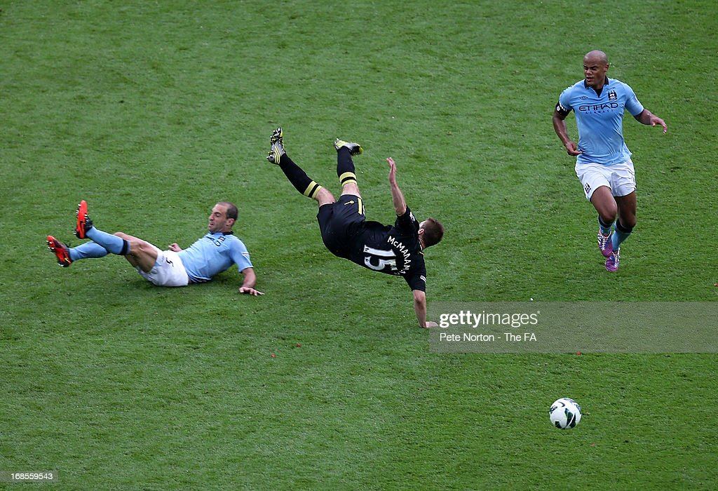 Pablo Zabaleta of Manchester City tackles <a gi-track='captionPersonalityLinkClicked' href=/galleries/search?phrase=Callum+McManaman&family=editorial&specificpeople=5872412 ng-click='$event.stopPropagation()'>Callum McManaman</a> of Wigan Athletic, after which he receives a second yellow card from referee Andre Marriner and is sent off during the FA Cup with Budweiser Final match between Manchester City and Wigan Athletic at Wembley Stadium on May 11, 2013 in London, England.