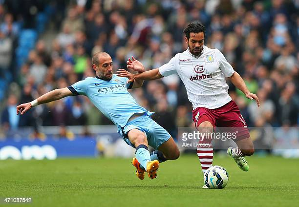 Pablo Zabaleta of Manchester City tackles Kieran Richardson of Aston Villa during the Barclays Premier League match between Manchester City and Aston...