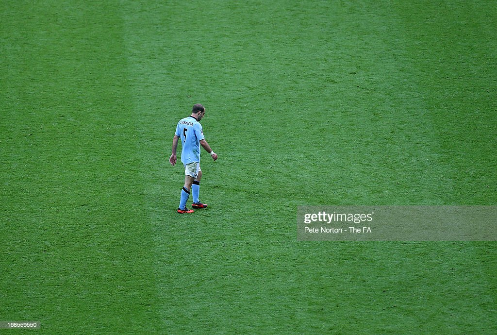 Pablo Zabaleta of Manchester City walks off the pitch after receiving a second yellow card from referee Andre Marriner and is sent off during the FA Cup with Budweiser Final match between Manchester City and Wigan Athletic at Wembley Stadium on May 11, 2013 in London, England.