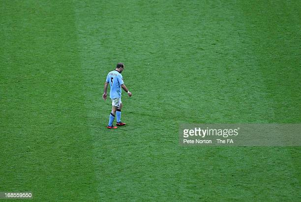 Pablo Zabaleta of Manchester City walks off the pitch after receiving a second yellow card from referee Andre Marriner and is sent off during the FA...