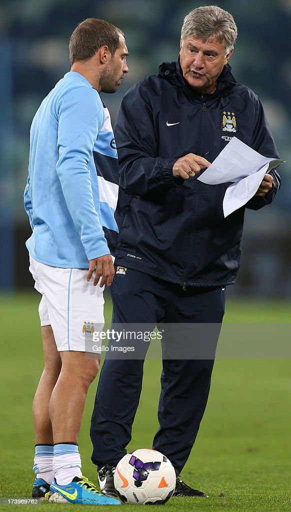 Pablo Zabaleta of Manchester City with Brian Kidd of Manchester City during the Nelson Mandela Football Invitational match between AmaZulu and Manchester City at Moses Mabhida Stadium on July 18, 2013 in Durban, South Africa.
